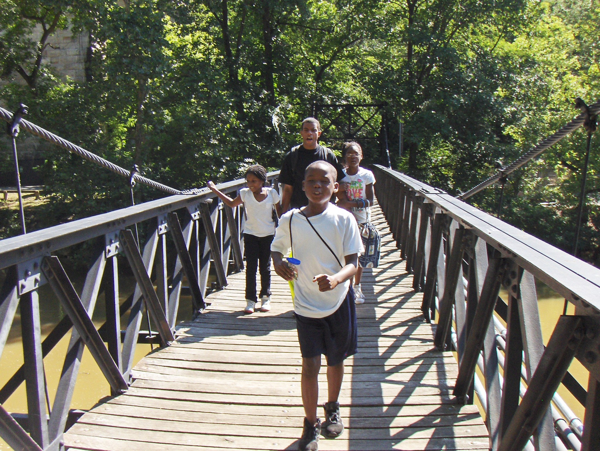 kids on swinging bridge